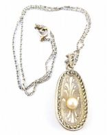 Vintage Sphinx Marcasite And Faux Pearl Pendant And Necklace.